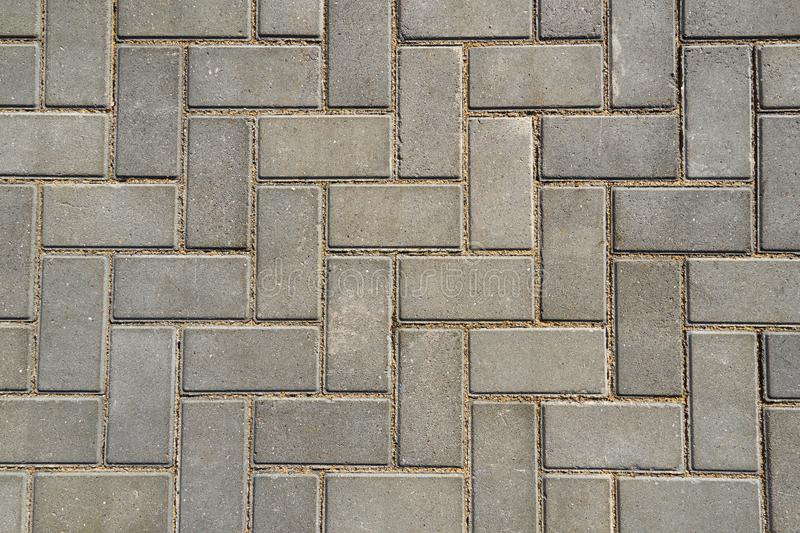 Gray paving tile for background or texture royalty free stock photography