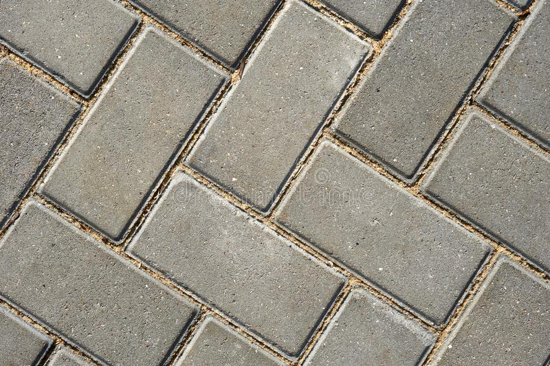 Gray paving tile for background or texture stock photography