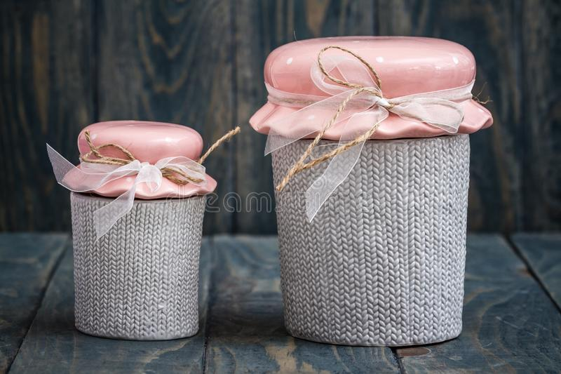 Gray and Pink Cute Decorative Ceramic Jars stock image