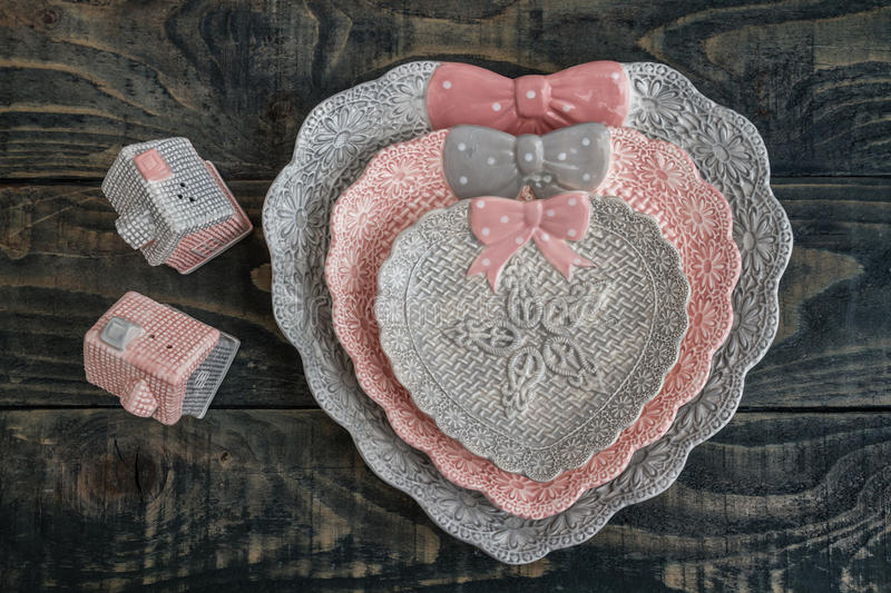 Gray and Pink Cute Decorative Plates and Salt Shakers stock photo