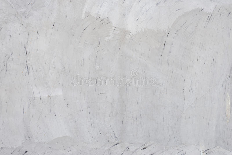 Gray polished concrete wall. Texture of the gray polished concrete wall with scratches for background royalty free stock photography