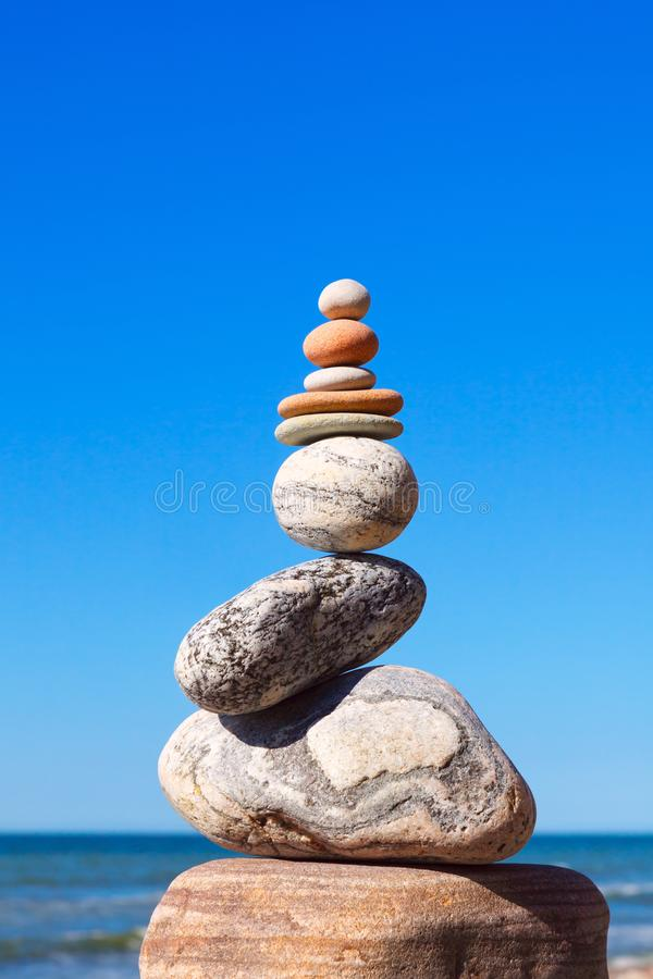 Gray and red zen stones on the background of the sea. Concept of harmony, balance and meditation.  royalty free stock image