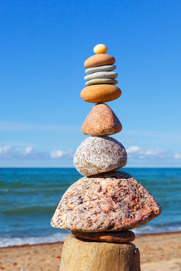 Gray and red zen stones on the background of the sea. Concept of harmony, balance and meditation.  stock photos