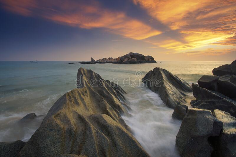 Gray Rock Formation Near Body Of Water During Sunset Free Public Domain Cc0 Image