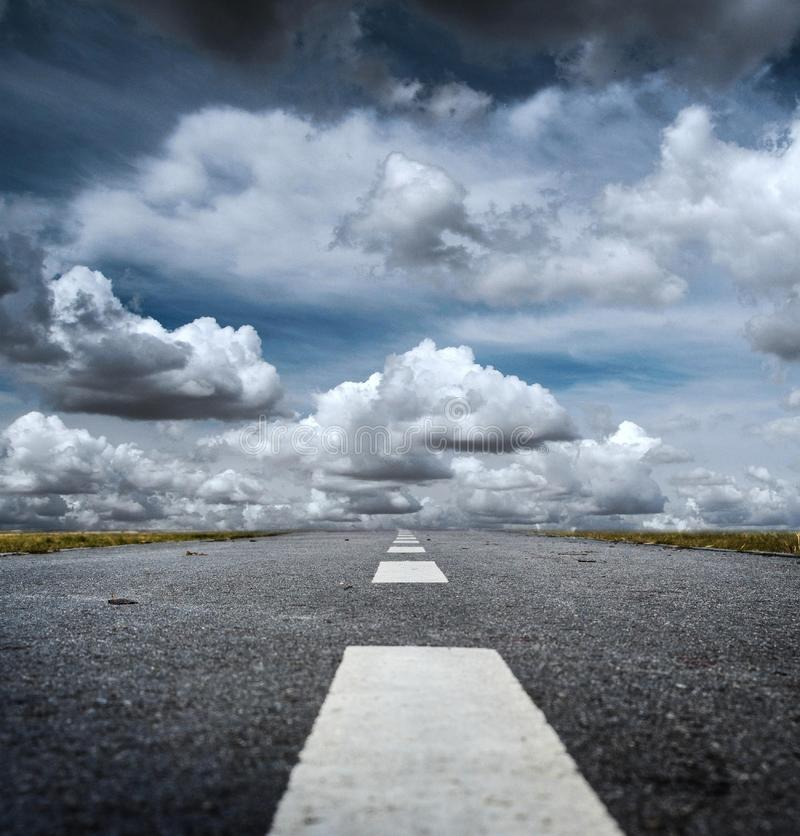 Gray Rolled Asphalt Road With Cumulus Clouds during Day royalty free stock image