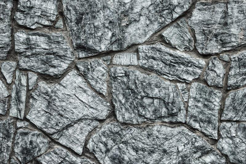 Gray stone wall texture - dark rock masonry gothic background stock photo