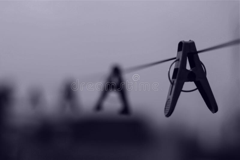 Gray Scale Image of Clothes Pin on Clothe's Line royalty free stock photo