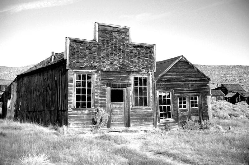 Gray Scale Photo of Brown Wooden House during Daytime stock photos