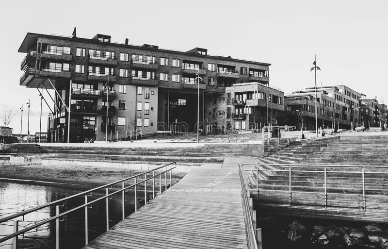 Gray Scale Photo of a Dock Near a Building stock photos