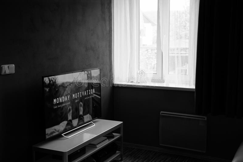 Gray Scale Photo of Flat Screen Tv on Top of Wooden Tv Rack royalty free stock photos