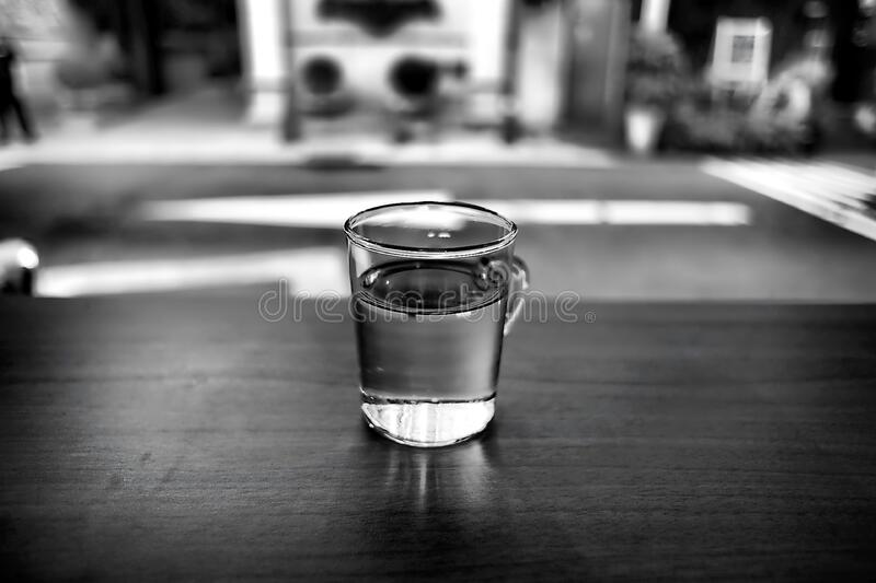 Gray Scale Photo of Glass With Water royalty free stock photography