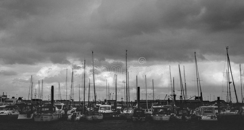 Gray Scale Photo of Group of Boats royalty free stock image