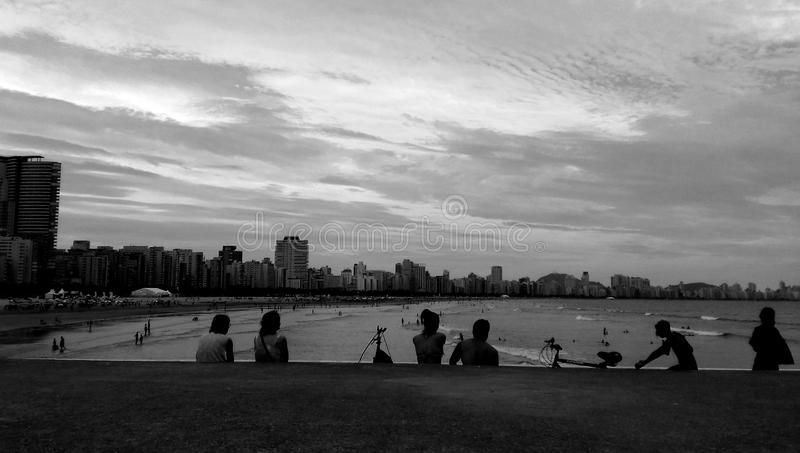 Gray Scale Photo of Group of People Near on Beach royalty free stock photo