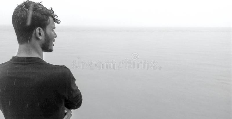Gray Scale Photo Of Man Wearing Black Shirt royalty free stock photography