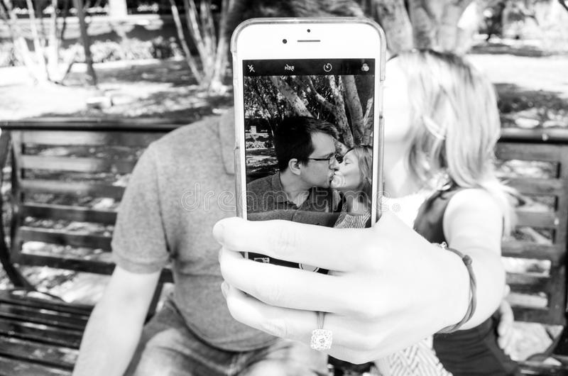 Gray Scale Photo of Man and Woman Taking a Selfie royalty free stock photography