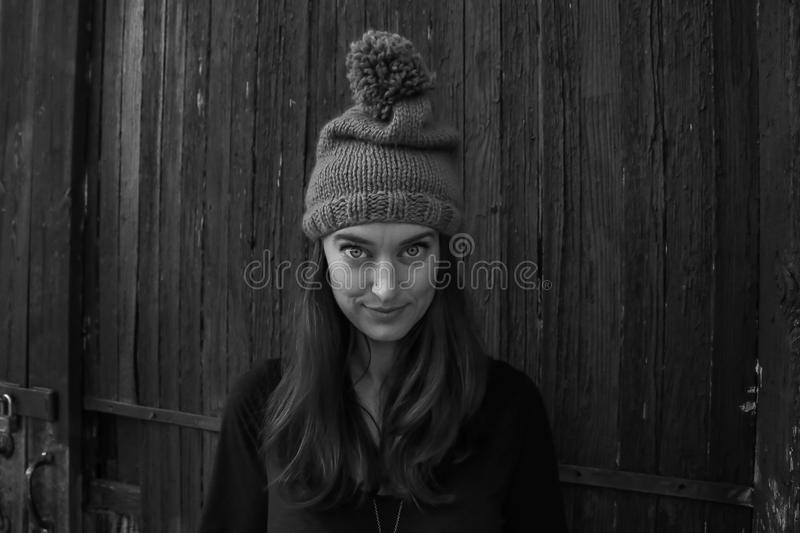 Gray Scale Photo of Woman Smiling in Front of the Camera stock photos