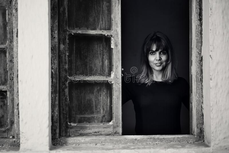 Gray Scale Photo of Woman in Window royalty free stock images