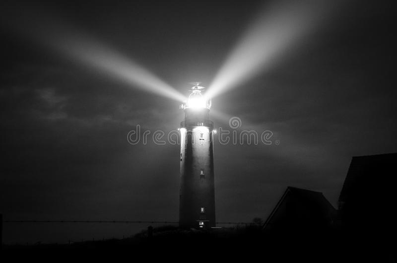 Gray Scale Photography of Lighthouse stock image