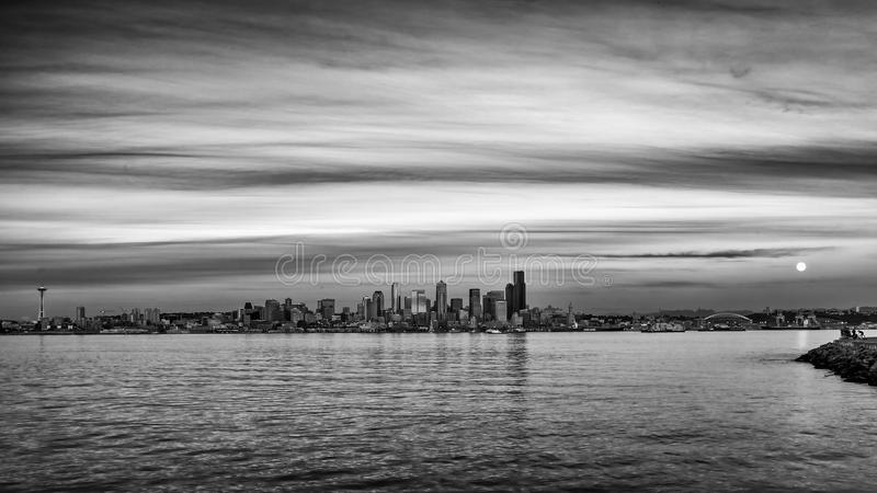 Gray scale shot of the coastline of the city of Seattle, USA with the cloudy sky in the background. A gray scale shot of the coastline of the city of Seattle royalty free stock image