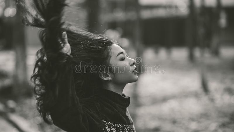 Gray Scale of Woman in Black Crew Neck Long Sleeve Shirt stock photo