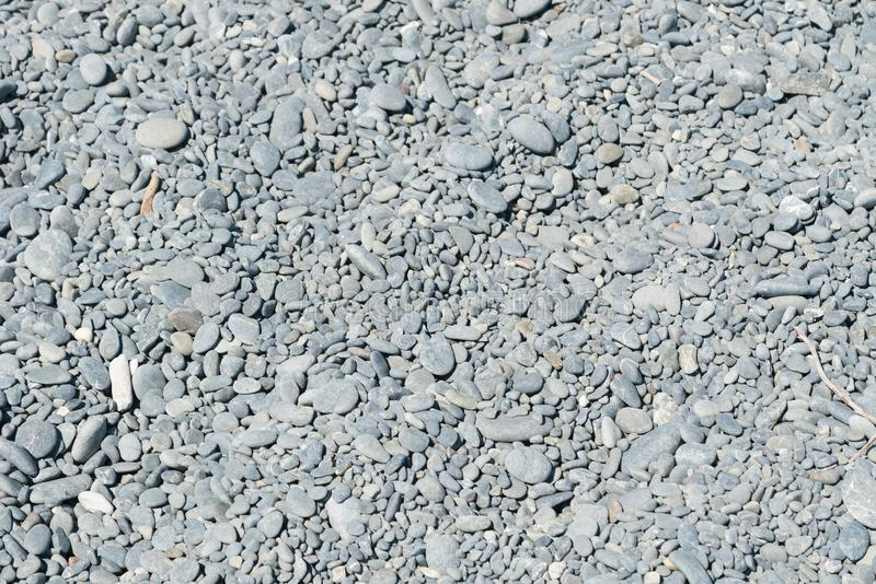 Gray sea stone on ground. Background and texture stock images