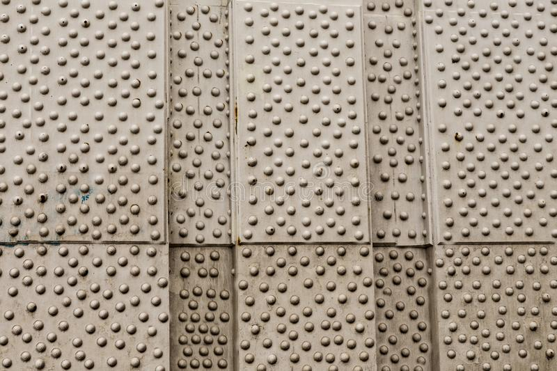 Gray silver background metal background pampered many rivets part of the bridge city design loft web design royalty free stock photo