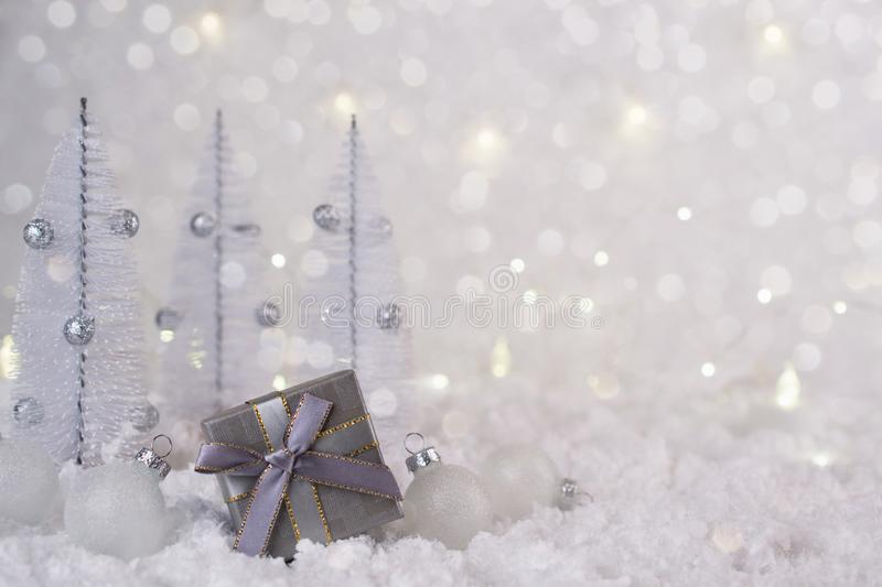 Gray silver gift box and Christmas decorations on a frosty background royalty free stock photography