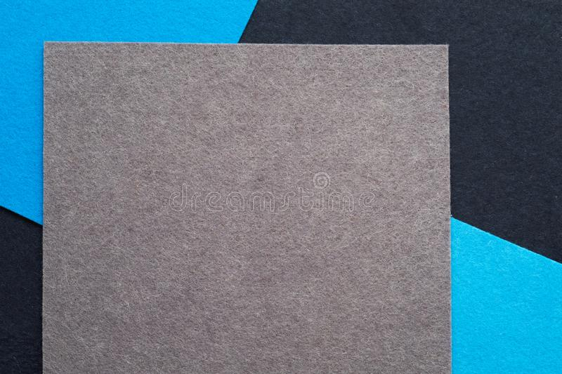 Gray blue felt texture layers geometric background stock image