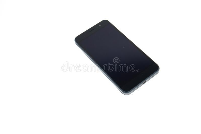 Gray smartphone on a white background with a place for text, side view. Gray smartphone on a white background with a place for text side view royalty free stock photo