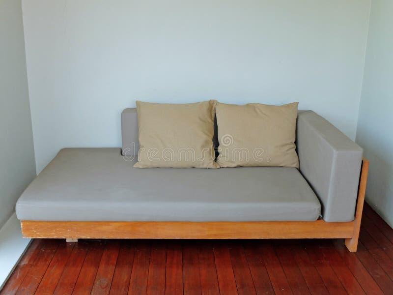 Gray Sofa Bed com dois descansos imagens de stock