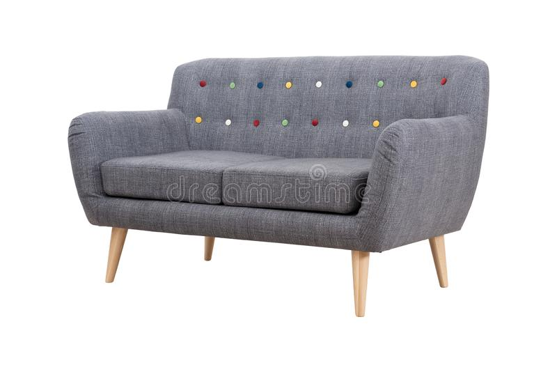 Gray sofa in Scandinavian style on wooden legs royalty free stock photography
