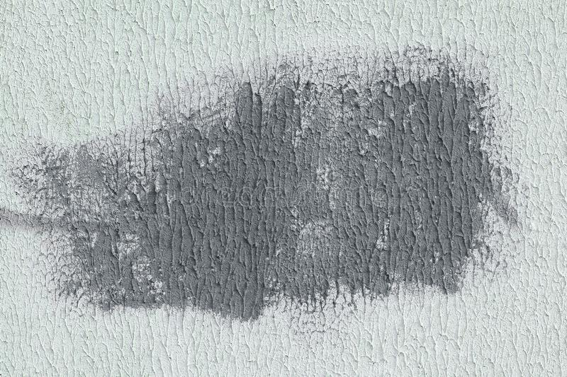 Gray spot on white textured paper. abstract background stock images