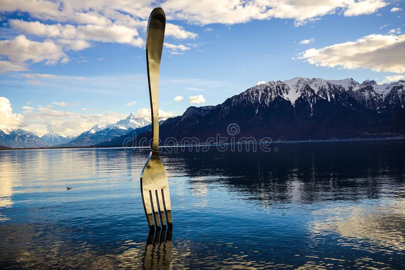 Gray Stainless Steel Fork on Water With Overlooking Mountain at Daytime stock image