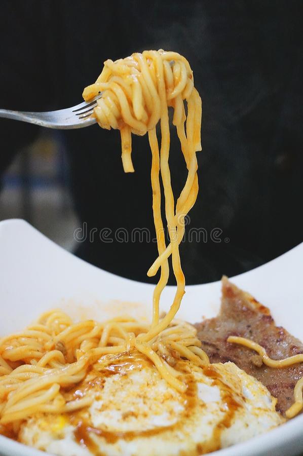 Gray Steel Fork With Yellow Pasta royalty free stock photo