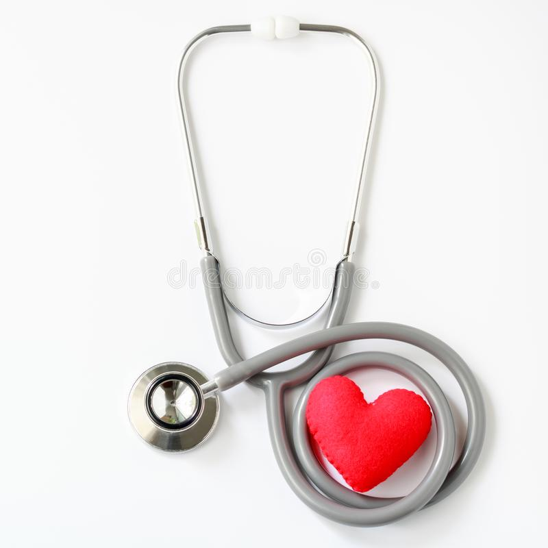 Gray stethoscope with red heart isolated on white background. Me stock image