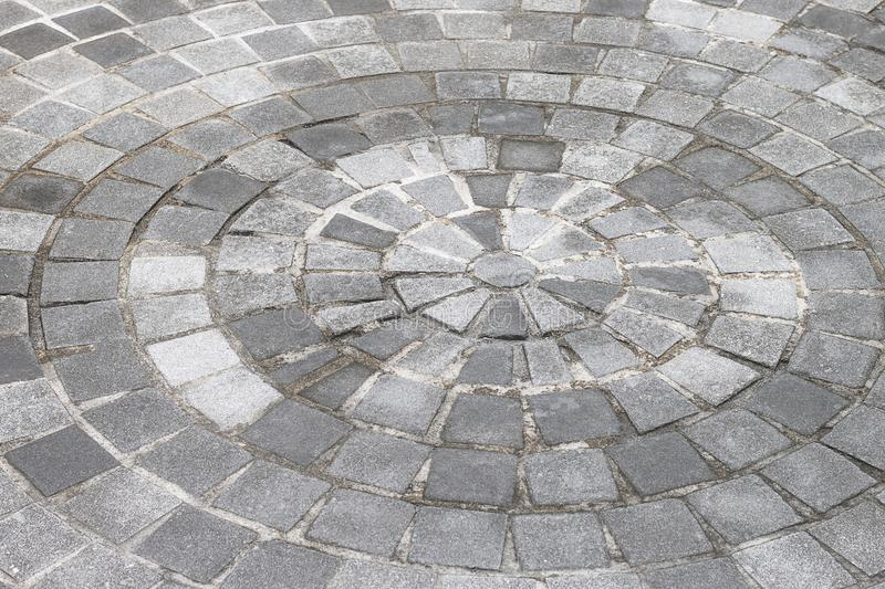 Gray stone circular path walkway. stock photo