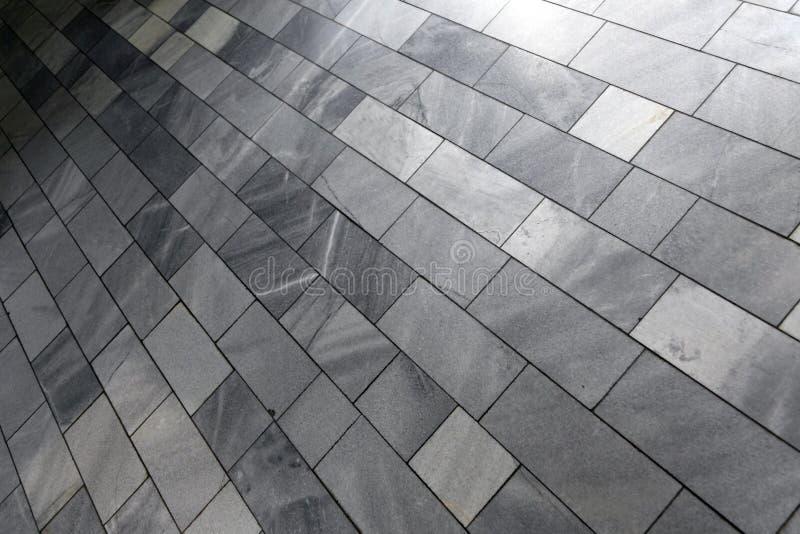 Gray stone floor. Close-up of a gray stone tiled floor stock photos