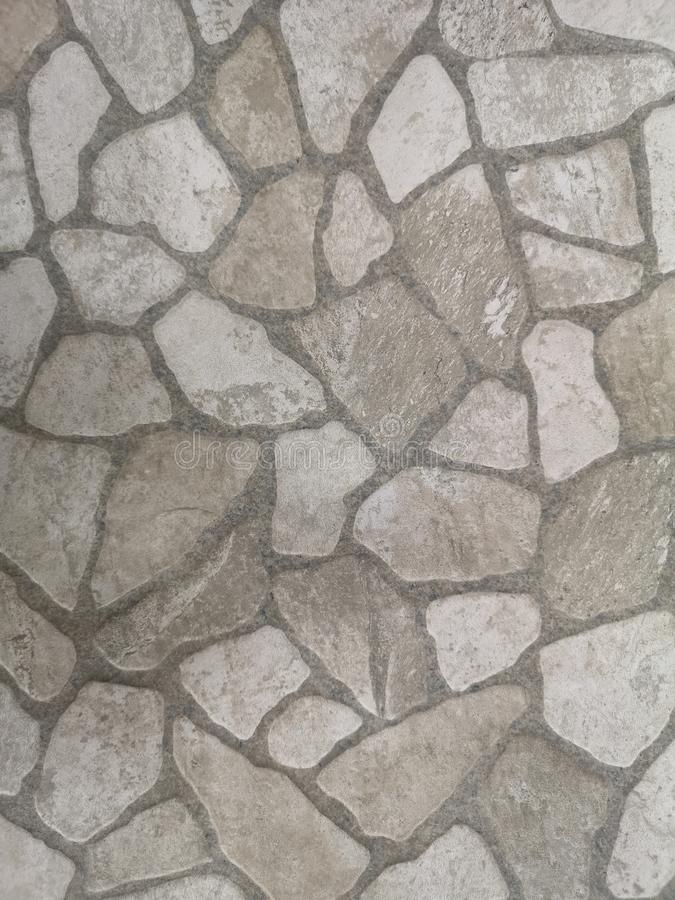 Gray stone freeform block brick floor rough surface texture material background stock image