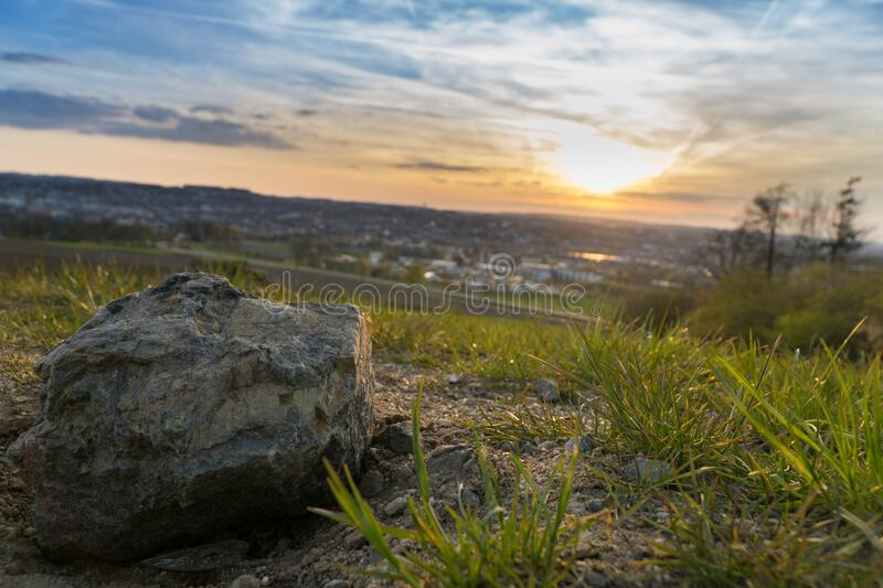 Gray Stone on Grassy Field during Under Cloudy Sky during Sunset royalty free stock image