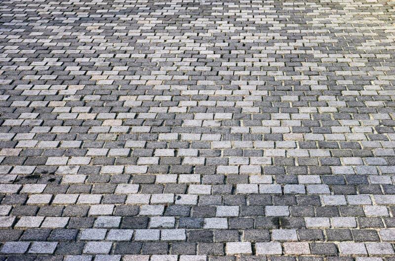 Gray stone paving slabs. Full frame royalty free stock photography