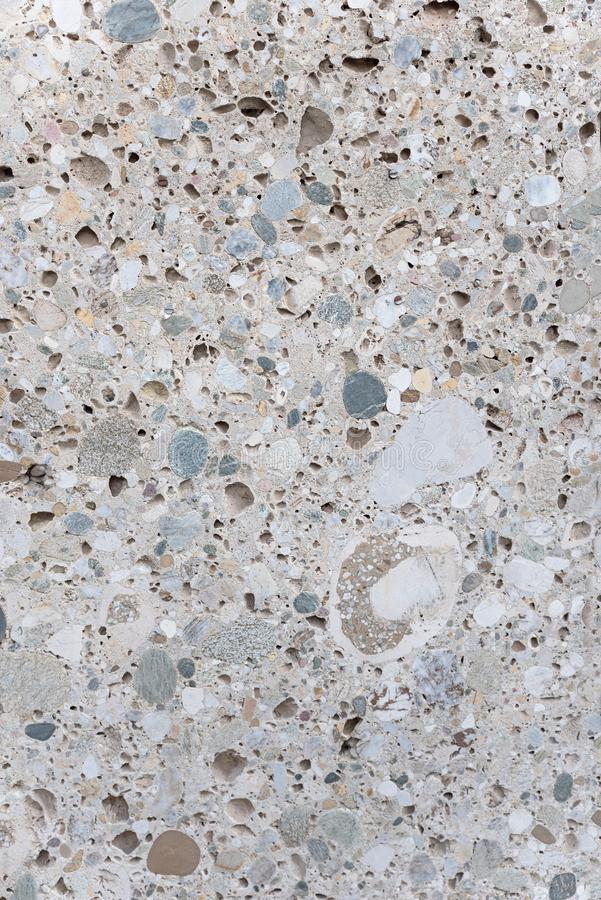 Gray stone slab with cut surface and mixture of pebbles and concrete royalty free stock photos
