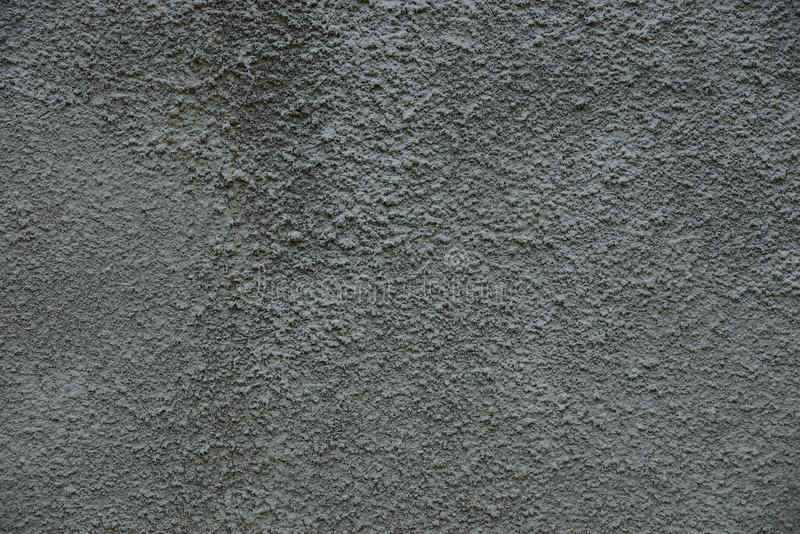 Gray stone texture from a part of a concrete wall of a building royalty free stock photo