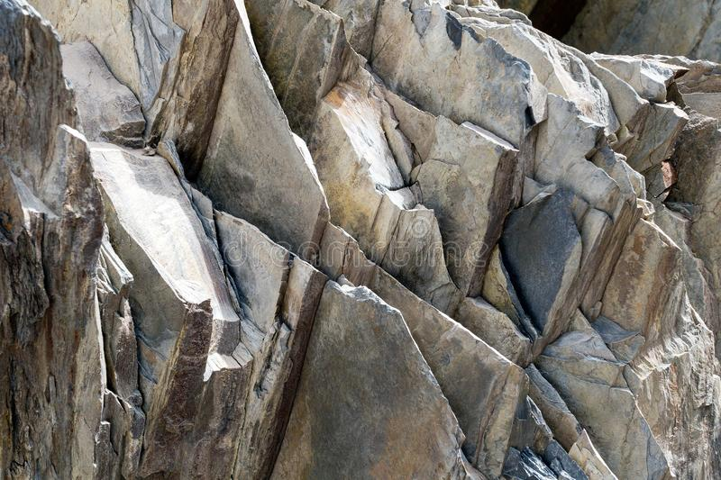 Gray stone texture of Rock layers. Bacground. Gray stone texture of Rock layers .Dark grey black slate background or texture pattern abstract old rough surface stock photography