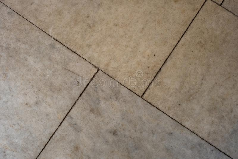 Gray stone tile surface, diagonal pattern. Abstraction royalty free stock photography