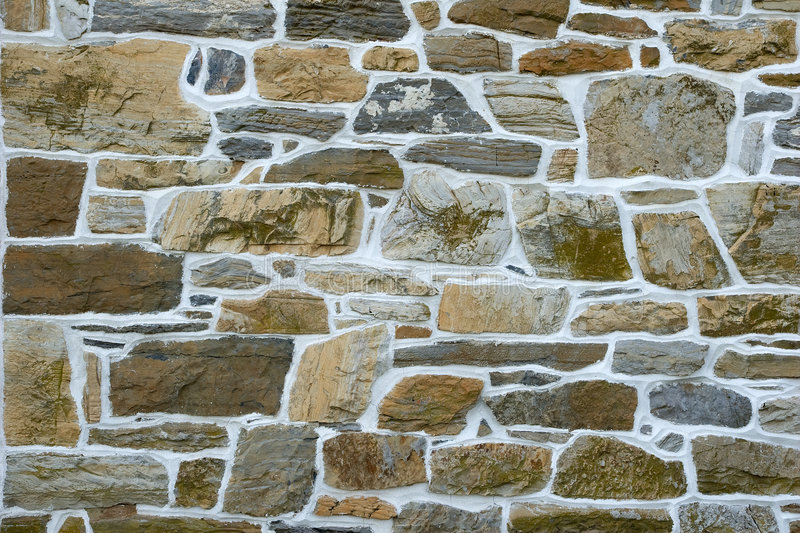 Gray stone wall. With white cement stock photography