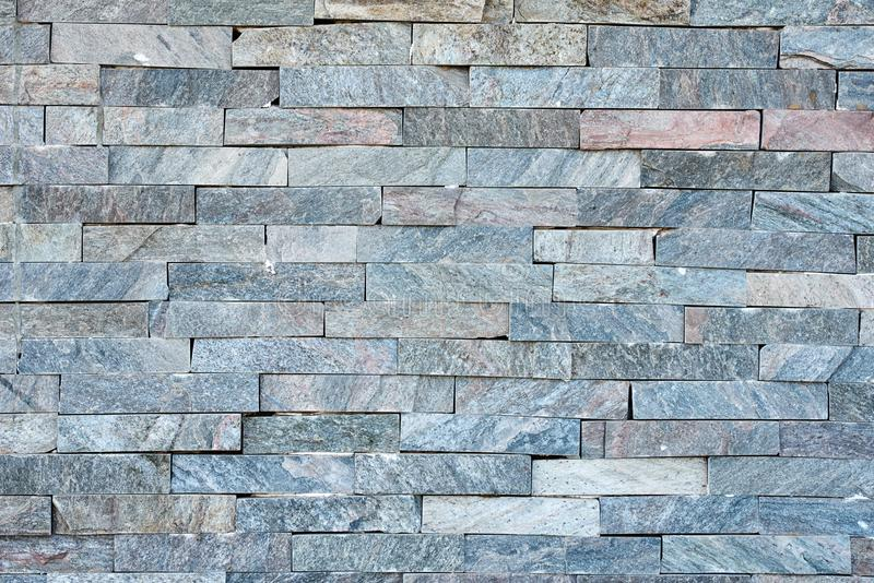 Gray stone wall as a background. Abstract texture. Gray stone wall as background. Abstract texture, rock, surface, pattern, architecture, concrete, block, brick royalty free stock photos