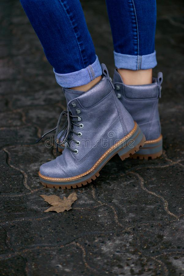 Gray stylish womans boots royalty free stock photos