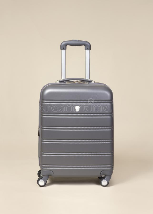 Gray suitcase isolated on plain background stock photography
