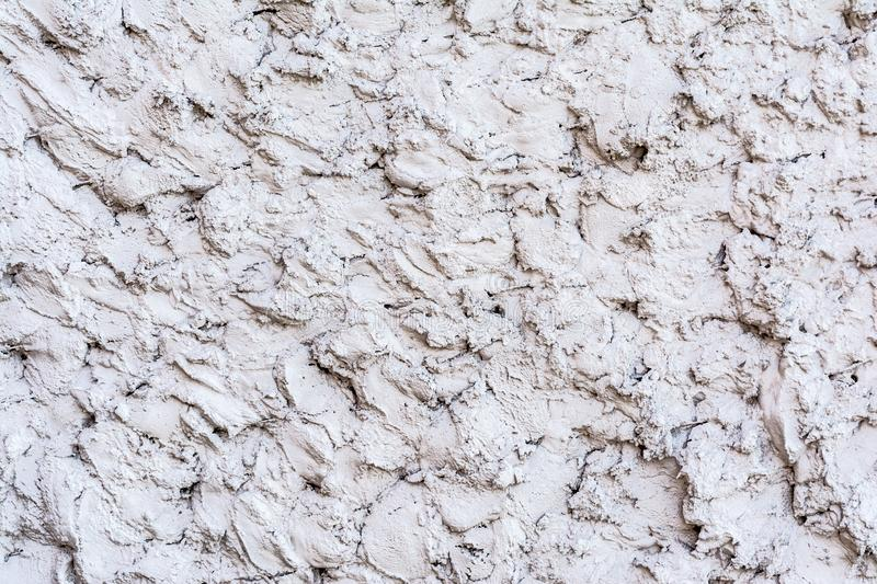 Gray texture of a concrete wall, layer of decorative plaster, abstract background stock images