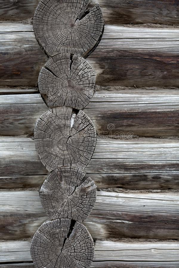 Gray texture of old round logs wall. Gray texture of old round logs house wall stock image